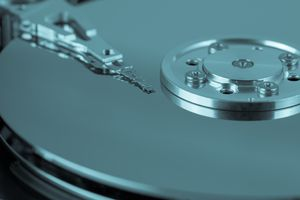 Close-up view of a hard drive platter and arm