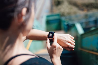 A woman looking at her smartwatch
