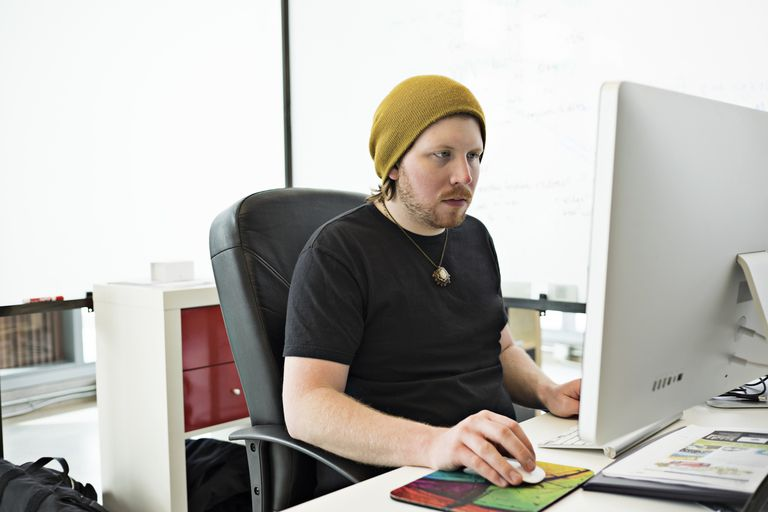 Software programmer working at computer
