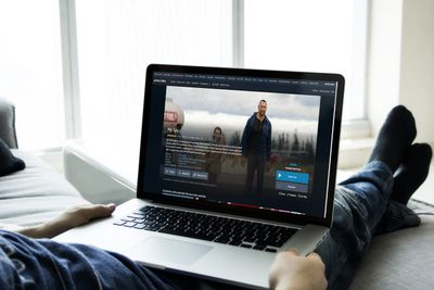 A persona setting up an Amazon Prime Video Watch Party on a laptop.