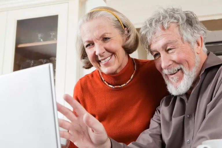 Grandparents enjoying a family call with Google Voice