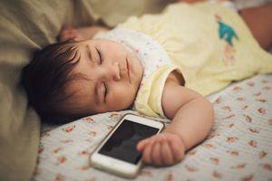 Sleeping baby near a mobile phone