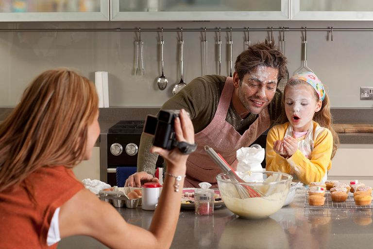 mother recording video of cooking family