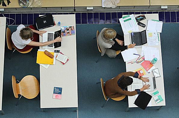 Arial View of Students Using Laptops