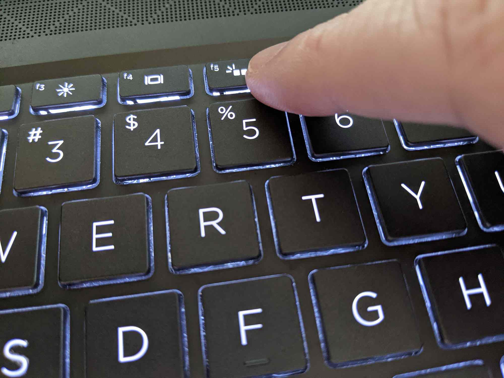Adjusting the brightness of a keyboard light.