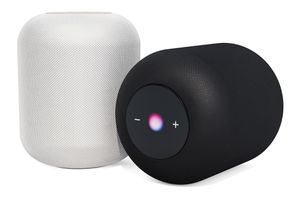 A white HomePod and a black homepod