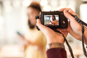 Digital camera taking picture of a woman