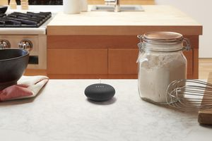 Google Home Mini in a kitchen.