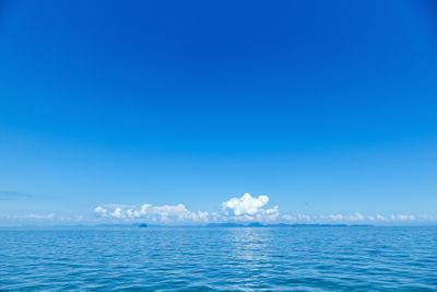 Blue sky and sea with clouds in the distance