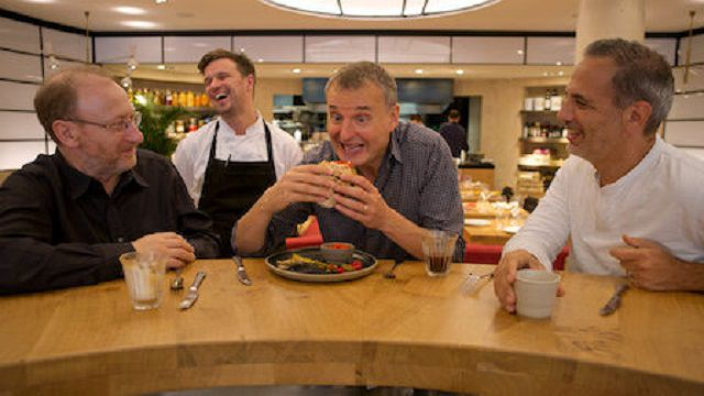 Phil Rosenthal delights over a sandwich in 'Somebody Feed Phil'