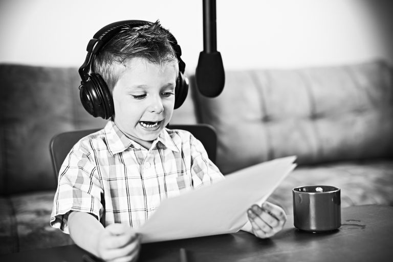 Young boy talking into a radio mic