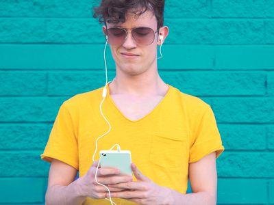 Man in yellow shirt listening to music