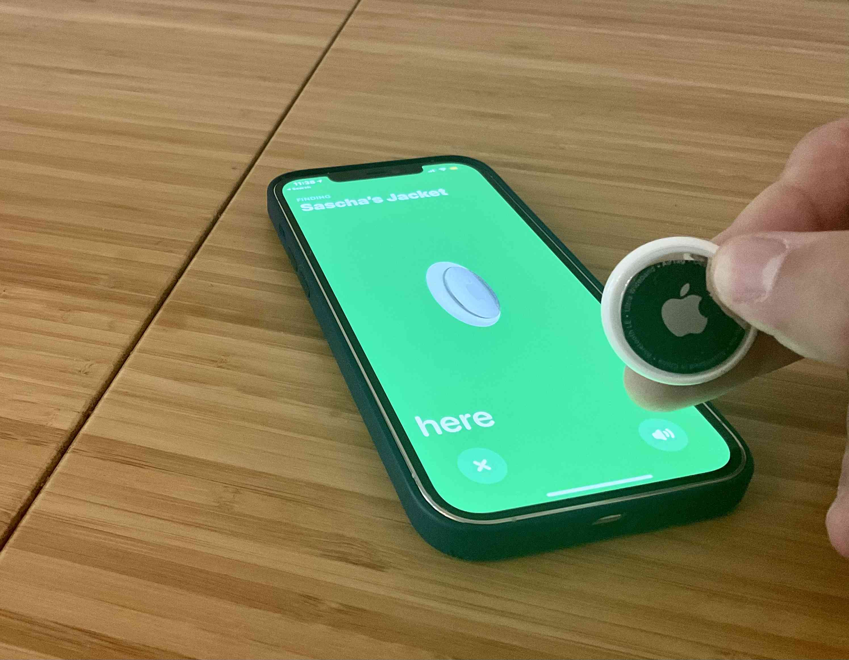Apple AirTag held near an iPhone