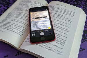 An iPhone using the Live Text feature with a book.