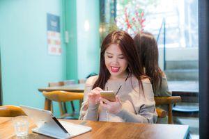 Happy woman using iphone
