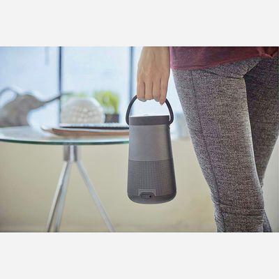 Woman holding Bose portable speaker