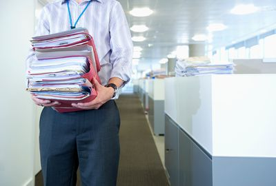 Person carrying paperwork in office