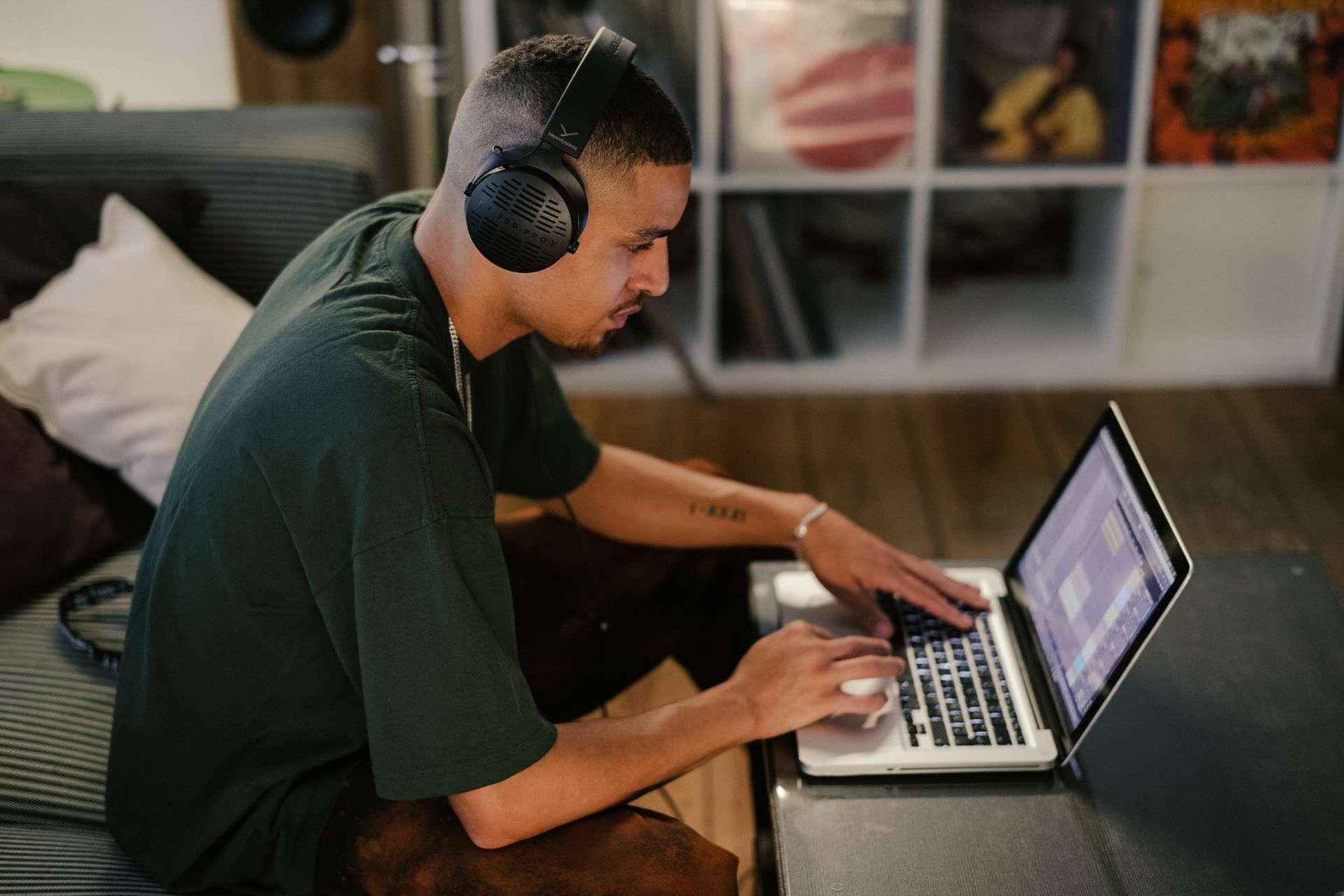 Man using Beyerdynamics DT 900 Pro X with laptop