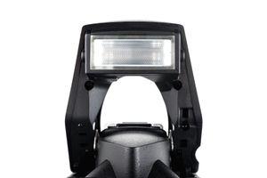Close up of a pop-up flash on digital camera