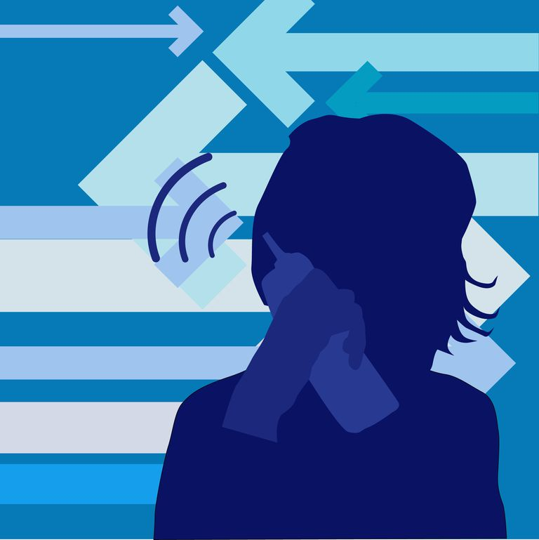 Silhouette of a woman talking on a cordless telephone