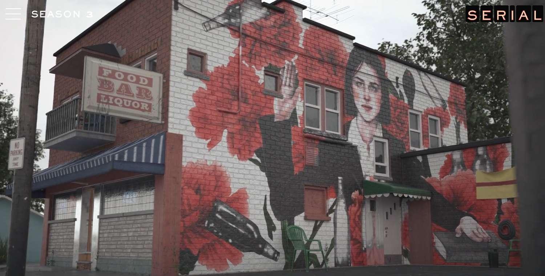 External shot of a bar with Serial mural