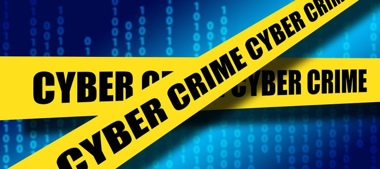 Ones and zeros covered by cyber crime tape.