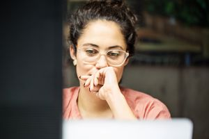 A woman using computer in an office