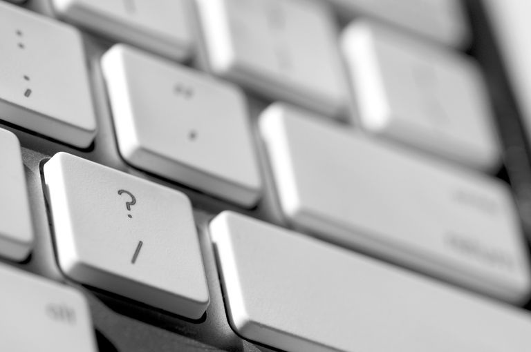 Closeup view of the question mark key on a computer keyboard
