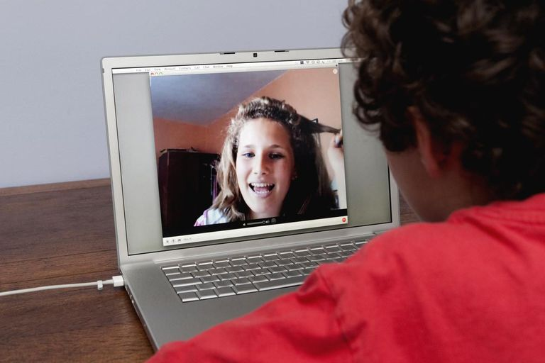 Teenagers talking via video call