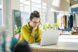 Fashion designer working at her laptop
