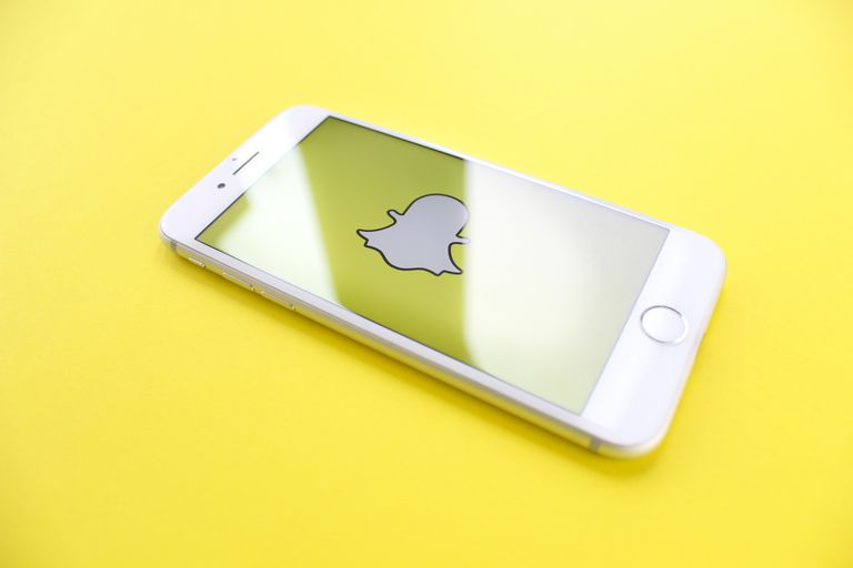 An image of the Snapchat ghost icon on a smartphone.