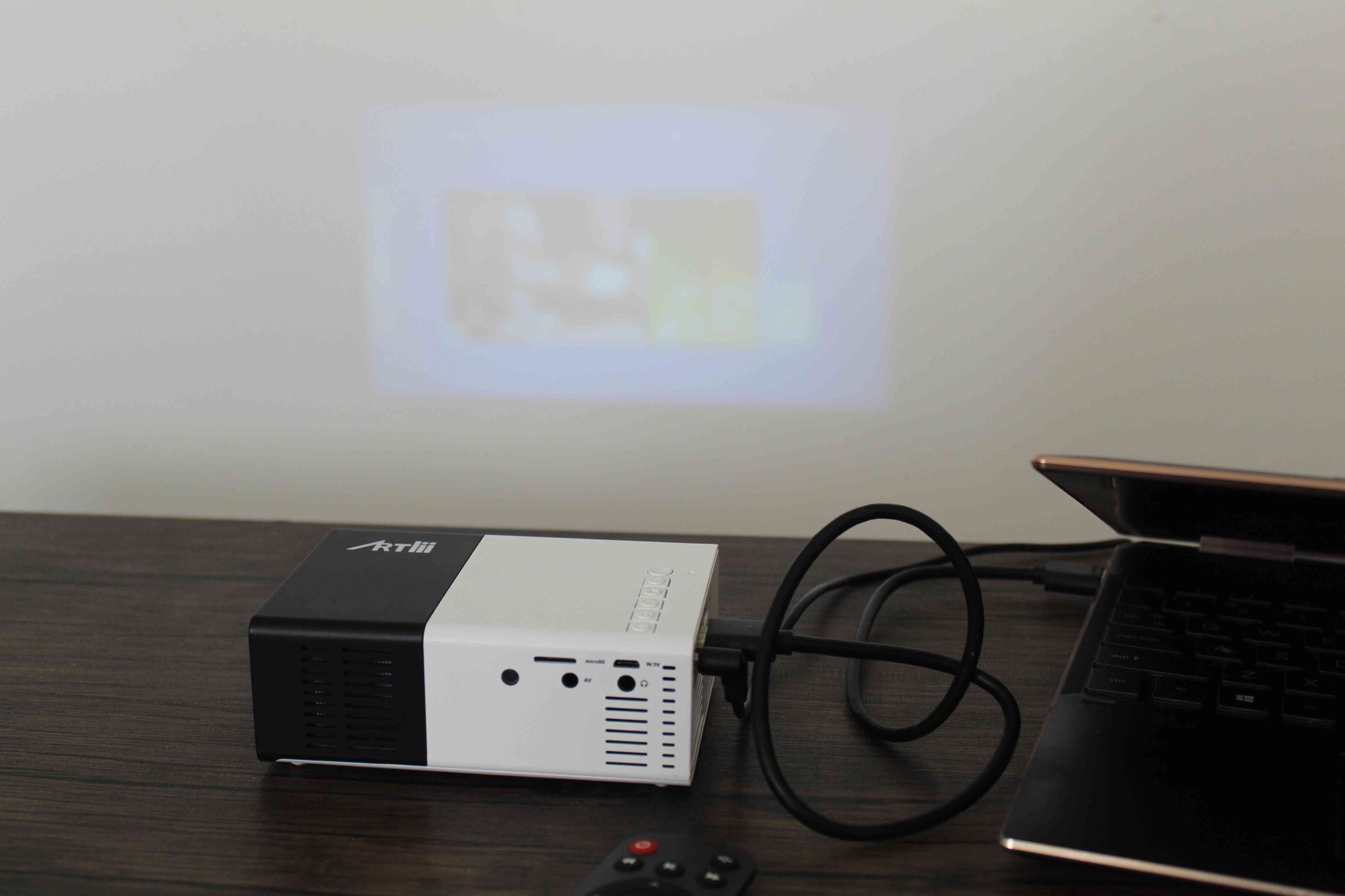 A projector hooked up to a laptop.