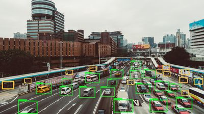 AI tracking vehicles, people, and images on a busy roadway.