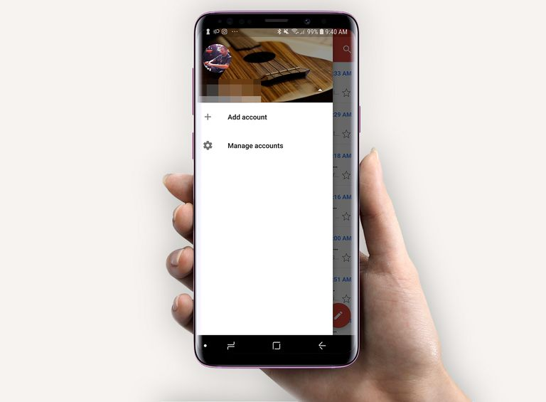 Hand holding Android phone with Gmail Add account on its screen