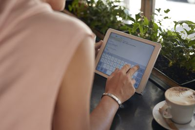 Close-up of female sending an email on an iPad