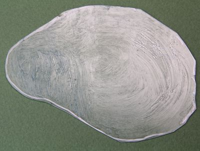 Clear styrene sheet textured with acrylic tar gel medium to make a model pool water surface