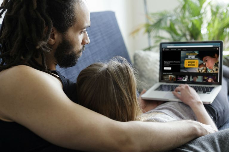 A couple watches the Criterion Channel on a laptop.