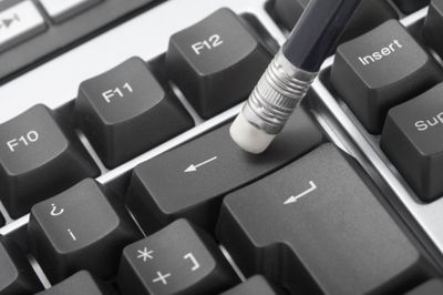 Picture of a pencil pressing down on the backspace key on a keyboard