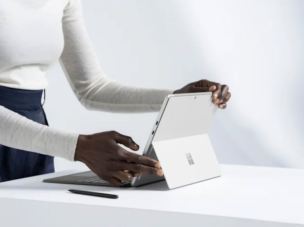 Someone setting up a Surface Pro 8 for use.