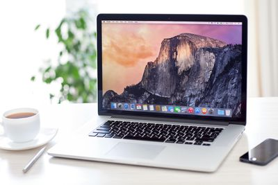 MacBook Pro with OS X Yosemite is on the table