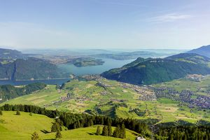 Magnificent panoramic aerial views of central Switzerland, mountains, villages and Lake Lucerne as you ascend the Cabrio cable car up Mount Stanserhorn in Switzerland. City of Stans.