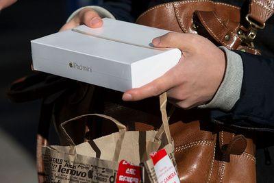 Shopper holding iPad mini box