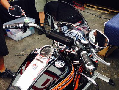 Motorcycle with handlebar speakers