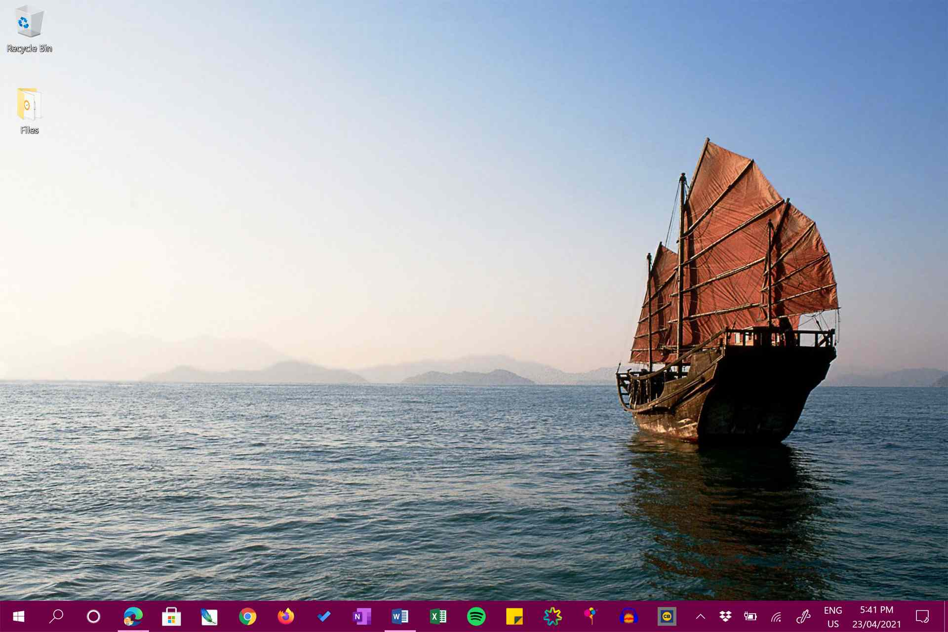 Windows 10 desktop with a ship background image.