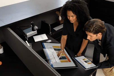 Two designers using Microsoft Surface Studio 2