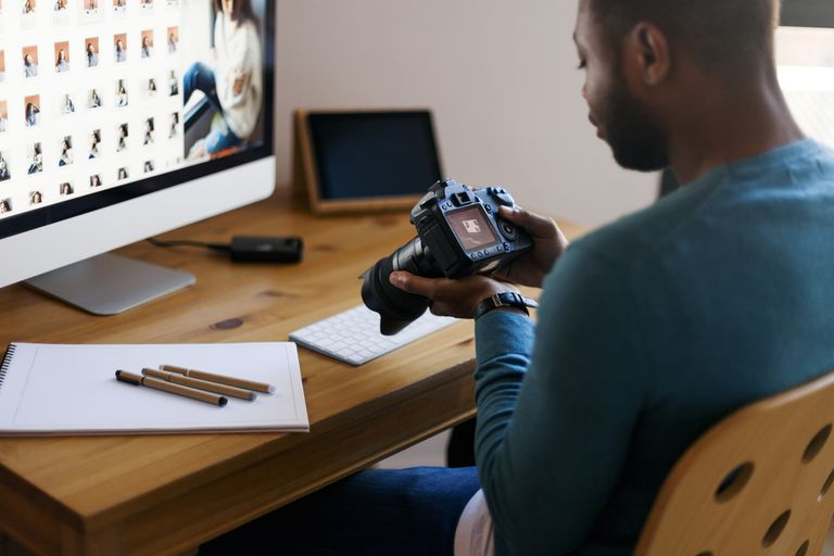 Image of a person searching for a photograph on a computer and on a p hone