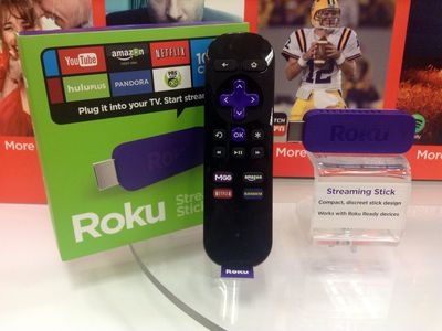 A Roku remote and USB stick.