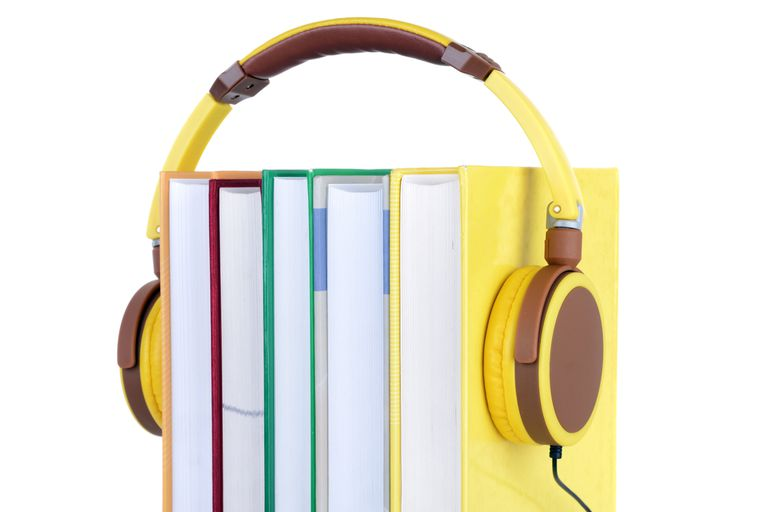 Audiobook concept - yellow headphones over 5 books