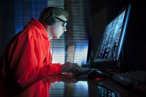 Hacker man at computer