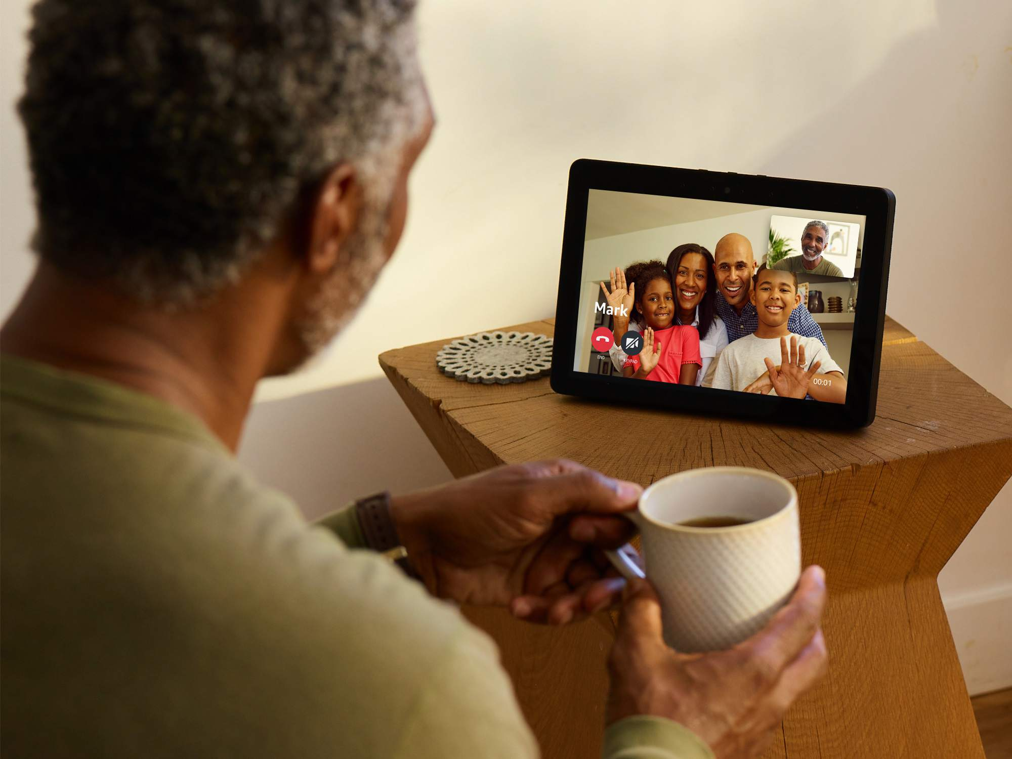 A grandparent talks with family using the Echo Show video call feature.